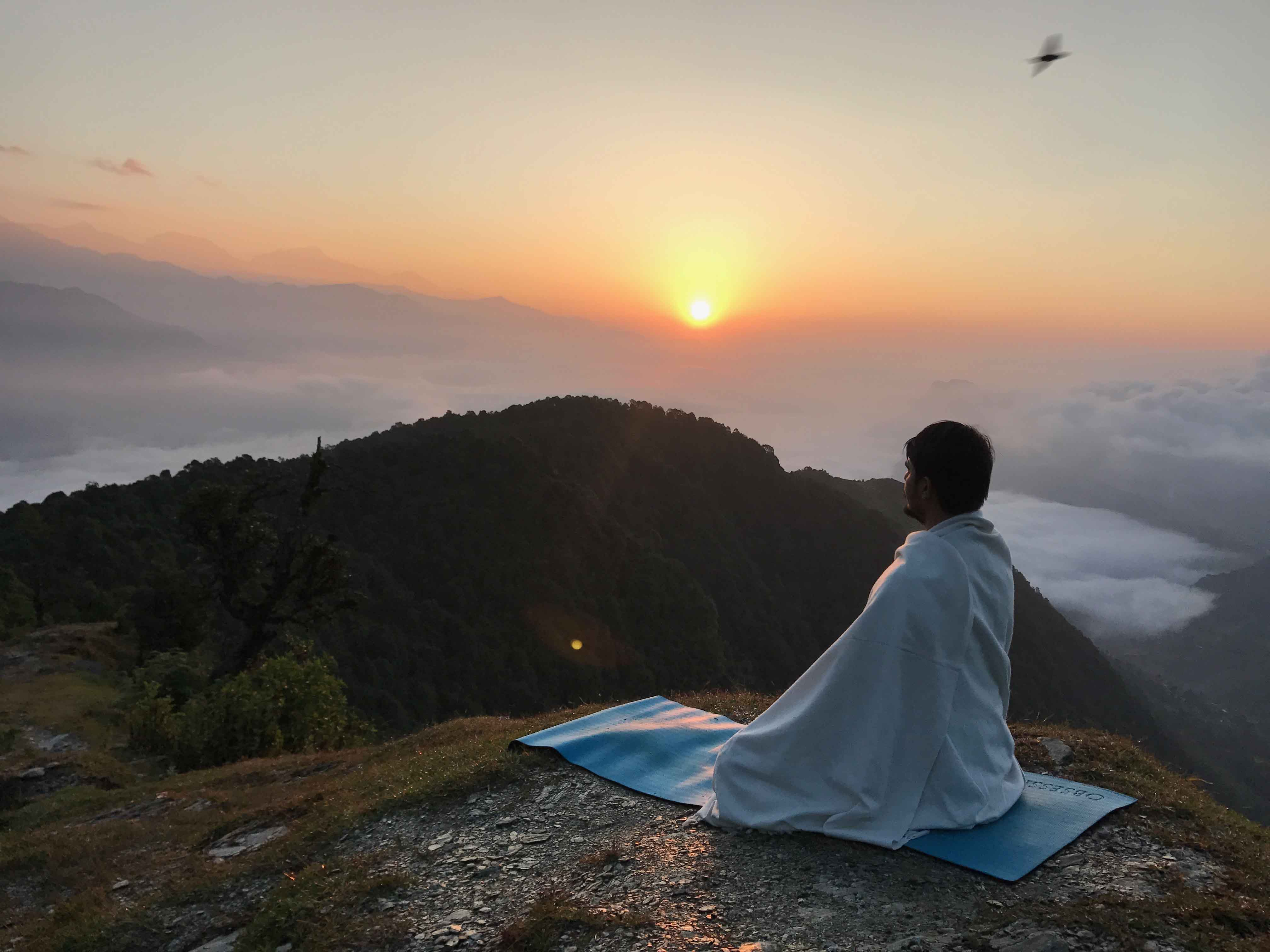 a yogi meditating in Himalayas