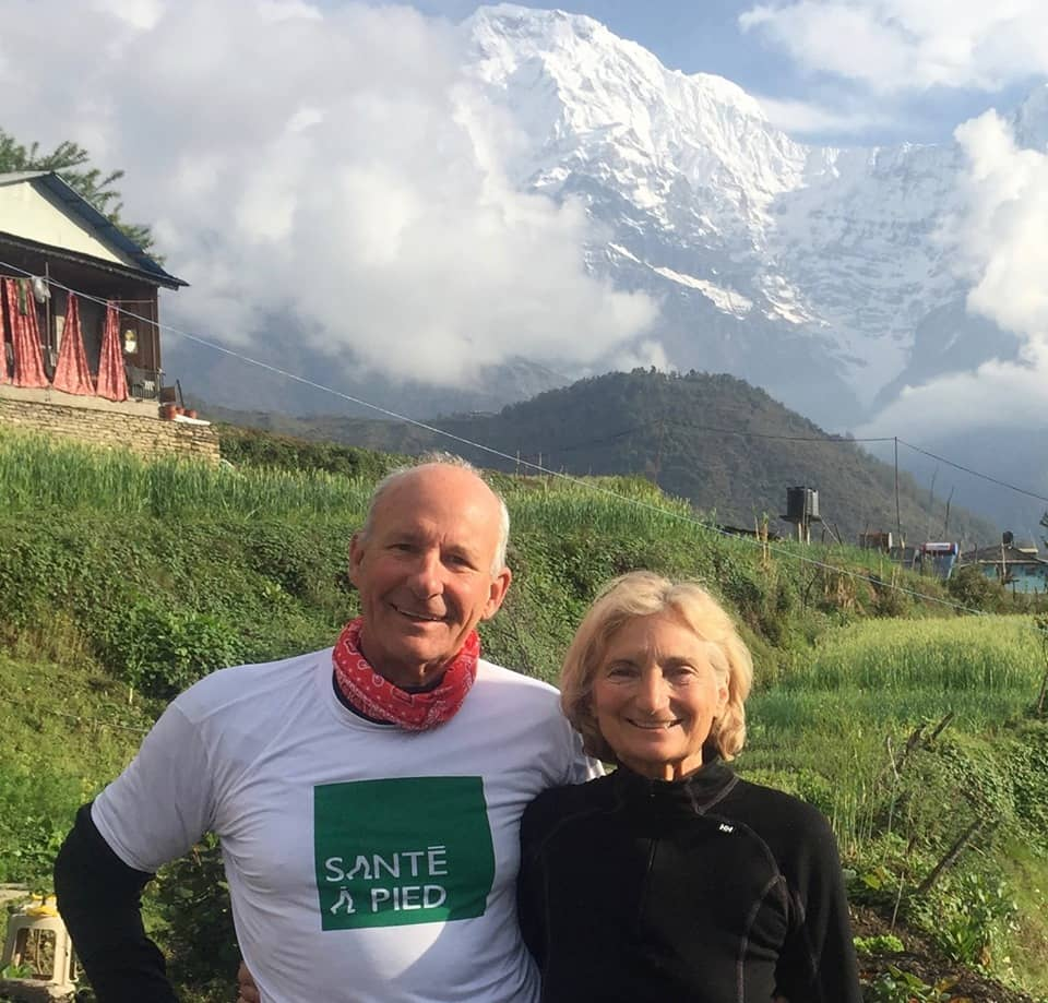 A couple standing in front of Himalayas