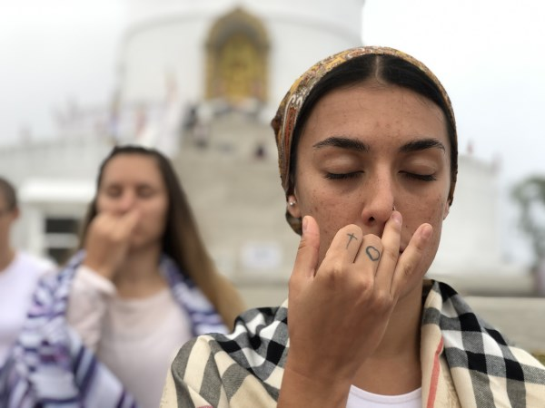 A girl doing breathing practice during Pranayama course in Himalayas