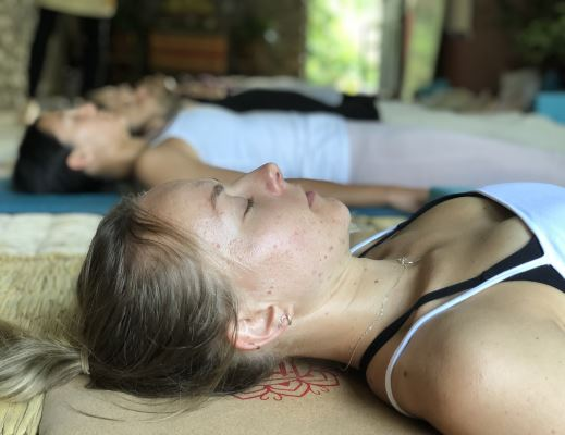 A girl lying on the Yoga mat during the Yoga Nidra Teacher Training