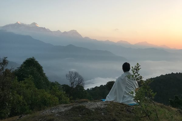 A person sitting in meditation after Yoga philosophy class